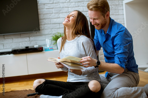 Young couple with a book