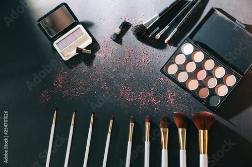 Leinwanddruck Bild professional makeup set isolated on black background