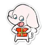 distressed sticker of a cute cartoon elephant with christmas present