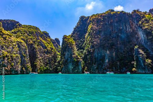Take a boat to see the beauty of Phi Phi Leh at Pileh Bay and Loh Samah Bay.