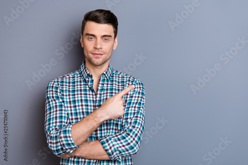 Close up photo attractive amazing he him his man hands arms finger show empty space perfect hair styling sale discount wearing casual plaid checkered outfit isolated grey background