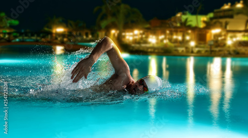 Professional man in swimming pool - 254725208