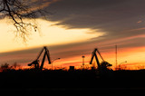 Excavators for loading coal on the background of the setting sun.