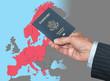 Senior man holding US passport on map of Schengen Zone of European Union in preparation for ETIAS visa