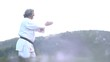Older adult man practicing outdoor karate.