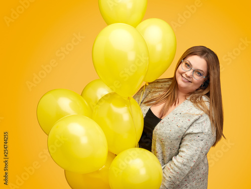 Smiling plump lady with balloons