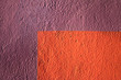 Textured background unpolished plaster painted with bright colors.