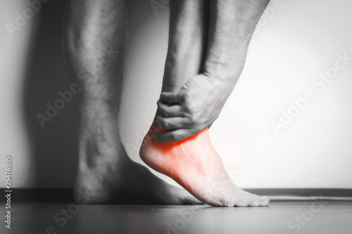 Leinwanddruck Bild man with pain in foot