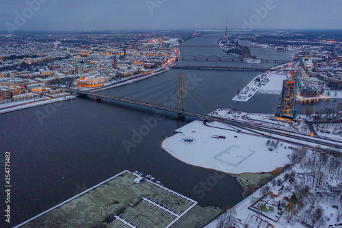 March 10, 2019. Riga, Latvia. Aerial view on the Swedbank building in Riga during winter evening at sunset. - 254771482