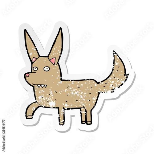 retro distressed sticker of a cartoon wild dog