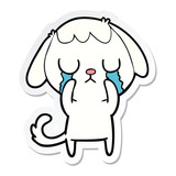 sticker of a cute cartoon dog crying
