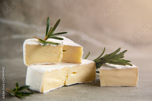 Cheese camembert or brie with fresh rosemary - 254849662