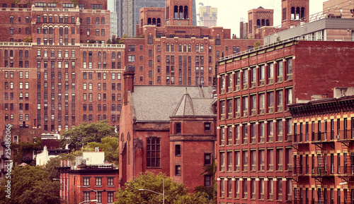 New York City old architecture, Living Coral color toning applied, USA.