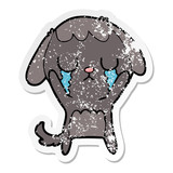distressed sticker of a cute cartoon dog crying