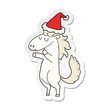 sticker cartoon of a horse wearing santa hat