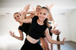 Leinwandbild Motiv Group of fit happy children exercising dancing and ballet in studio together