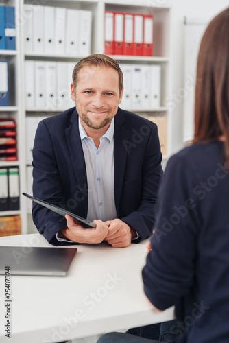 Foto Murales Smiling confident businessman in a meeting
