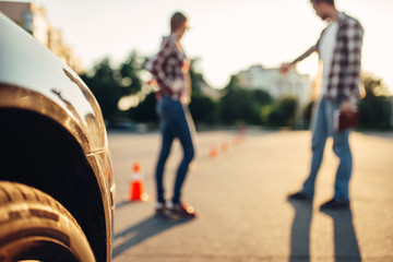 Instructor and student, exam for novice drivers