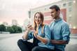 Leinwanddruck Bild - Phone addict couple cannot live without gadgets