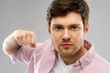 Leinwanddruck Bild - violence, aggression and people concept - angry young man ready for fists punch over grey background