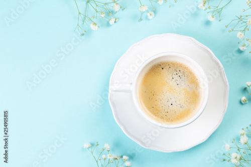 Good morning concept - coffee, flowers, notebook, blue background top view © anaumenko
