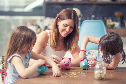 Happy Family mom daughter save money piggy bank future investment savings