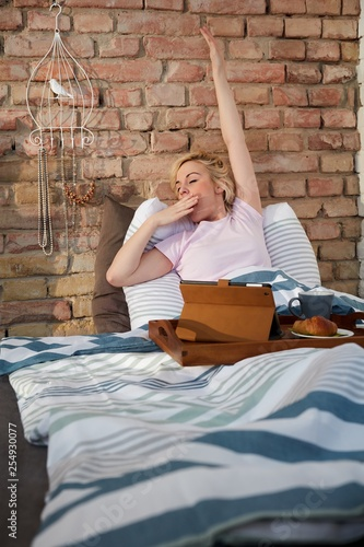 Yawning woman in the morning