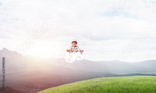 Leinwanddruck Bild Young boy keeping mind conscious.