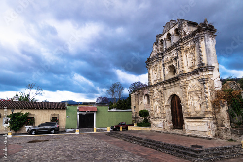 Church fassade ruin of Ermita de Santa Isabel with dramatic cloudscape, Antigua, Guatemala