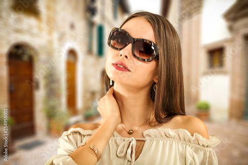 Summer time and slim young woman with sunglasses.
