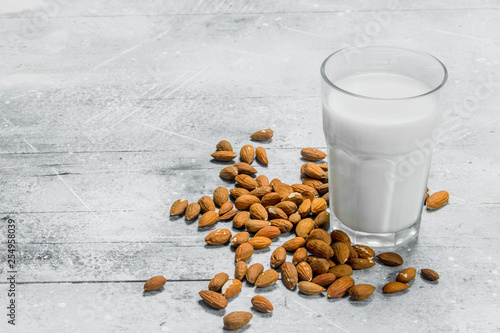Almond milk in a glass . © OlesyaSH