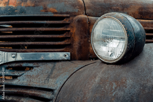 obraz lub plakat Old antique rusty hot rod Dodge truck grill, with round headlight and fender