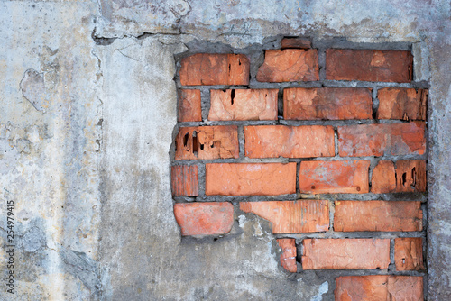 Old brick wall with peeling plaster, grunge background - 254979415