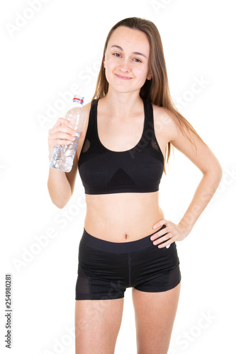 Leinwanddruck Bild Young sport athletic woman wearing black clothes holding water bottle in gym