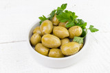 pickled green olives olea europaea  mediterraneandecorated with parsley in a white bowl