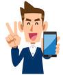 スマートフォンを手に持ちピースサインを示す男性