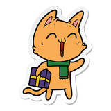sticker of a happy cartoon cat with christmas gift