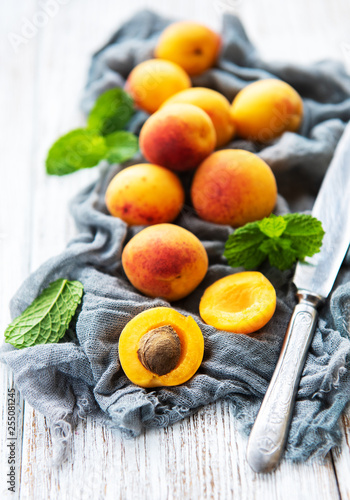 Fresh apricots on a table - 255081245