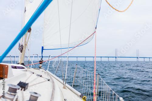 Yacht and oresund bridge between denmark sweden - 255088667