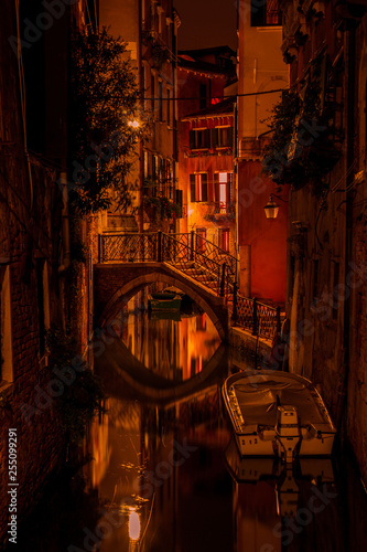 Long exposure. View of the bridge over canal in Venice, Italy, at night. - 255099291