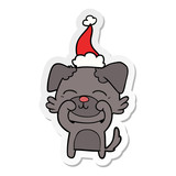 sticker cartoon of a dog wearing santa hat