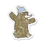 retro distressed sticker of a cartoon bear wearing hat