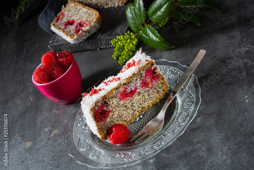 poppy seed cake with raspberries and grated coconut