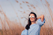 Woman Wearing Mirror Sunglasses in Outdoor Fashion Portrait