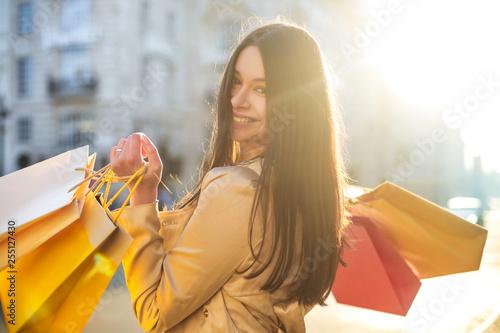 fototapeta na ścianę Cheerful woman doing shopping in a big city
