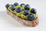Fresh delicious homemade sandwich with blueberry and avocado.