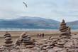 Leinwandbild Motiv Zen rocks beach on the west coast of Ireland, Family walking on the beach in the distance