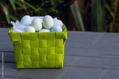 chocolate eggs in a green presentation basket
