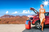 Summer car on road and slim young woman