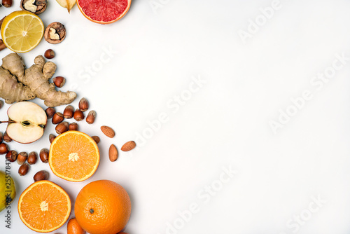 group of raw orange fruit on white background - 255178431